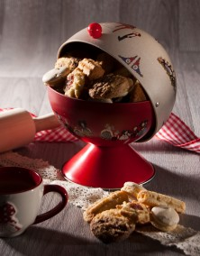 Hansi red sugar bowl filled with biscuits