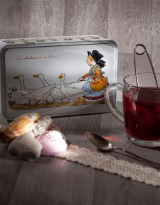 "Sugar tin with Hansi ""Girl tending geese"" decoration"